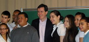 Stephen Colbert poses for a photo with Manhattan Bridges High School students