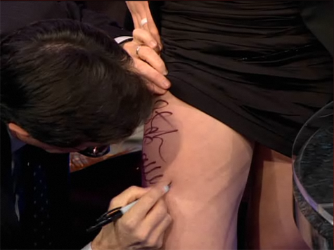 Stephen Colbert signs Katherine Reutter's thigh - December 14, 2009